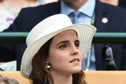Emma Watson attends day twelve of the Wimbledon Lawn Tennis Championships at All England Lawn Tennis and Croquet Club on July 14, 2018 in London, England.