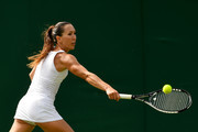Jelena Jankovic of Serbia plays a backhand during the Ladies Singles first round match against Agnieszka Radwanska of Poland on day two of the Wimbledon Lawn Tennis Championships at the All England Lawn Tennis and Croquet Club on July 4, 2017 in London, England.