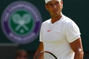 Rafael Nadal of Spain looks on during his Men's Singles first round match against serves against Dudi Sela on day two of the Wimbledon Lawn Tennis Championships at All England Lawn Tennis and Croquet Club on July 3, 2018 in London, England.