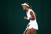 Vitalia Diatchenko of Russia celebrates match point against Maria Sharapova of Russia during their Ladies' Singles first round match on day two of the Wimbledon Lawn Tennis Championships at All England Lawn Tennis and Croquet Club on July 3, 2018 in London, England.