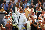 Rafael Nadal of Spain signals to his fans as he leaves Centre Court after winning his Men's Singles first round match against Dudi Sela of Isreal on day two of the Wimbledon Lawn Tennis Championships at All England Lawn Tennis and Croquet Club on July 3, 2018 in London, England.