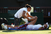 Vitalia Diatchenko of Russia is treated for an injury during her Ladies' Singles first round match against Maria Sharapova of Russia on day two of the Wimbledon Lawn Tennis Championships at All England Lawn Tennis and Croquet Club on July 3, 2018 in London, England.