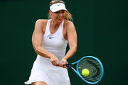 Maria Sharapova of Russia plays a backhand in her Ladies' Singles first round match against Pauline Parmentier of France during Day two of The Championships - Wimbledon 2019 at All England Lawn Tennis and Croquet Club on July 02, 2019 in London, England.