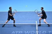 Britain's Jamie Murray (R) and Brazil's Bruno Soares (L) eye the ball against USA's Bob Bryan and USA's Mike Bryan during their men's doubles match on day two of the ATP World Tour Finals tennis tournament at the O2 Arena in London on November 13, 2017. / AFP PHOTO / Glyn KIRK