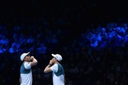 USA's Bob Bryan (L) and USA's Mike Bryan (R) watch a hawkeye line call decision during their men's doubles match against Britain's Jamie Murray and Brazil's Bruno Soares on day two of the ATP World Tour Finals tennis tournament at the O2 Arena in London on November 13, 2017. / AFP PHOTO / Glyn KIRK