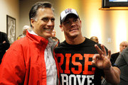 Republican presidential candidate, former Massachusetts Gov. Mitt Romney (L) poses with professional wrestler John Cena during the driver's meeting prior to the start of the NASCAR Sprint Cup Series Daytona 500 at Daytona International Speedway on February 26, 2012 in Daytona Beach, Florida.