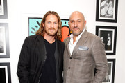 "Actor Jason Lewis (L) and De Re Gallery owner Steph Sebbag attend Best Buddies ""The Art of Friendship"" Benefit Photo Auction, hosted by De Re Gallery, on March 3, 2016 in West Hollywood, California."