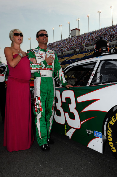 Kevin Harvick, driver of the #33 Hunt Brothers Pizza Chevrolet, and his wife DeLana Harvick stand on the grid during pre-race ceremonies for the NASCAR Nationwide Series Feed The Children 300 at Kentucky Speedway on June 29, 2012 in Sparta, Kentucky. (June 28, 2012 - Source: Jared C. Tilton/Getty Images North America)