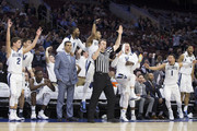 Collin Gillespie #2, Dhamir Cosby-Roundtree #21, Mikal Bridges #25, Phil Booth #5, Donte DiVincenzo #10, Jalen Brunson #1 and Omari Spellman #14 of the Villanova Wildcats celebrate from the bench while head coach Jay Wright looks on after a three point basket by Denny Grace in the second half against the DePaul Blue Demons at the Wells Fargo Center on February 21, 2018 in Philadelphia, Pennsylvania. The Villanova Wildcats defeated the DePaul Blue Demons 93-62.
