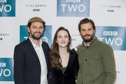 Matthew Rhys, Ann Skelly and Jamie Dornan attend a photocall for 'Death and Nightingales' at Soho Hotel on November 26, 2018 in London, England.