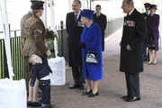"""Two year old Alfie Lun is held by his mother as Britain's Queen Elizabeth II arrives to unveil The Iraq and Afghanistan memorial at Victoria Embankment Gardens in central London on March 9, 2017..The preceding """"Service of Dedication"""" honoured the service and duty of both the UK Armed Forces and civilians in the Gulf region, Iraq and Afghanistan, and those who supported them back home, from 1990-2015 / AFP PHOTO / POOL / Toby Melville"""
