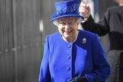 Queen Elizabeth II arrives with flowers for the unveiling of the new memorial to members of the armed services who served and died in the wars in Iraq and Afghanistan at Victoria Embankment Gardens on March 8, 2017 in London, England.