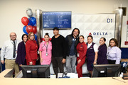 Delta employees pose as Bernie Williams, Johnny Damon, and Delta, the official airline of the New York Yankees, celebrate the 2019 Yankees at LaGuardia Airport on October 18, 2019 in New York City.