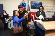 The boarding process as Bernie Williams, Johnny Damon, and Delta, the official airline of the New York Yankees, celebrate the 2019 Yankees at LaGuardia Airport on October 18, 2019 in New York City.