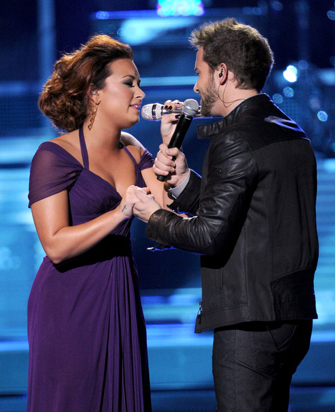 Demi Lovato Singers Demi Lovato (L) and Pablo Alboran perform onstage during the 12th annual Latin GRAMMY Awards at the Mandalay Bay Events Center on November 10, 2011 in Las Vegas, Nevada.