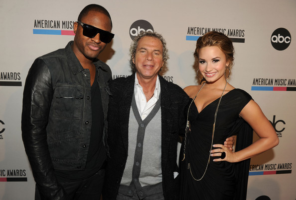 Demi Lovato (L-R) Recording artist Taio Cruz, DCP Producer Larry Klein and Demi Lovato attend the 2010 American Music Awards Nominations Press Conference held at The Mixing Room at the JW Marriott Los Angeles at L.A. LIVE on October 12, 2010 in Los Angeles, California.