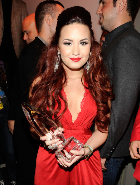 "Demi Lovato Singer/Actress Demi Lovato with the award for ""Favorite Pop Artist"" attends the 2012 People's Choice Awards at Nokia Theatre L.A. Live on January 11, 2012 in Los Angeles, California."