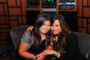 Actress/singer Demi Lovato (R) and sister actress Madison De La Garza attend a Live Chat at Cambio Studios on July 21, 2011 in Hollywood, California.