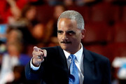 Former U.S. Attorney General Eric Holder walks on stage to delivers remarks on the second day of the Democratic National Convention at the Wells Fargo Center, July 26, 2016 in Philadelphia, Pennsylvania. Democratic presidential candidate Hillary Clinton received the number of votes needed to secure the party's nomination. An estimated 50,000 people are expected in Philadelphia, including hundreds of protesters and members of the media. The four-day Democratic National Convention kicked off July 25.