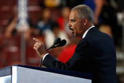 Former U.S. Attorney General Eric Holder delivers remarks on the second day of the Democratic National Convention at the Wells Fargo Center, July 26, 2016 in Philadelphia, Pennsylvania. Democratic presidential candidate Hillary Clinton received the number of votes needed to secure the party's nomination. An estimated 50,000 people are expected in Philadelphia, including hundreds of protesters and members of the media. The four-day Democratic National Convention kicked off July 25.