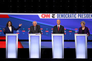 Sen. Kamala Harris (D-CA) speaks as Sen. Bernie Sanders (I-VT), former Vice President Joe Biden, and Sen. Elizabeth Warren (D-MA) look on during the Democratic Presidential Debate at Otterbein University on October 15, 2019 in Westerville, Ohio. A record 12 presidential hopefuls are participating in the debate hosted by CNN and The New York Times.