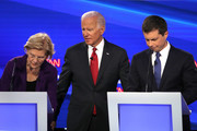 Former Vice President Joe Biden, Sen. Elizabeth Warren (D-MA) and South Bend, Indiana Mayor Pete Buttigieg react during a break at the Democratic Presidential Debate at Otterbein University on October 15, 2019 in Westerville, Ohio. A record 12 presidential hopefuls are participating in the debate hosted by CNN and The New York Times.