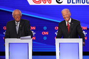 Sen. Bernie Sanders (I-VT) and former Vice President Joe Biden react during the Democratic Presidential Debate at Otterbein University on October 15, 2019 in Westerville, Ohio. A record 12 presidential hopefuls are participating in the debate hosted by CNN and The New York Times.