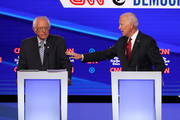 Sen. Bernie Sanders (I-VT) and former Vice President Joe Biden interact during the Democratic Presidential Debate at Otterbein University on October 15, 2019 in Westerville, Ohio. A record 12 presidential hopefuls are participating in the debate hosted by CNN and The New York Times.