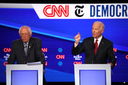 Sen. Bernie Sanders (I-VT) (L) and former Vice President Joe Biden participate in the Democratic Presidential Debate at Otterbein University on October 15, 2019 in Westerville, Ohio. A record 12 presidential hopefuls are participating in the debate hosted by CNN and The New York Times.