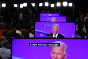 Former Vice President Joe Biden appears on television screens in the Media Center during the Democratic Presidential Debate at Otterbein University on October 15, 2019 in Westerville, Ohio. A record 12 presidential hopefuls are participating in the debate hosted by CNN and The New York Times.