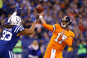 Brock Osweiler #17 of the Denver Broncos throws a pass under pressure from Jabaal Sheard #93 of the Indianapolis Colts during the first half at Lucas Oil Stadium on December 14, 2017 in Indianapolis, Indiana.