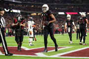 Wide receiver Larry Fitzgerald #11 of the Arizona Cardinals reacts after scoring a four yard touchdown against the Denver Broncos during the third quarter at State Farm Stadium on October 18, 2018 in Glendale, Arizona.