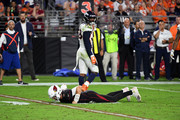 Quarterback Josh Rosen #3 of the Arizona Cardinals lies on the ground after being hit by linebacker Von Miller #58 of the Denver Broncos at State Farm Stadium on October 18, 2018 in Glendale, Arizona.