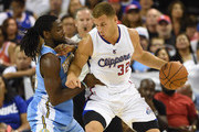 Blake Griffin #32 of the Los Angeles Clippers drives against Kenneth Faried #35 of the Denver Nuggets during their preseason game at the Mandalay Bay Events Center on October 18, 2014 in Las Vegas, Nevada. NOTE TO USER: User expressly acknowledges and agrees that, by downloading and or using this photograph, User is consenting to the terms and conditions of the Getty Images License Agreement.