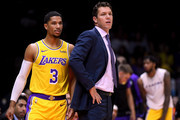 Heac coach Luke Walton of the Los Angeles Lakers and Josh Hart #3 watch play during a preseason game against the Denver Nuggets at Valley View Casino Center on September 30, 2018 in San Diego, California.
