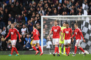 Nicklas Bendtner of Nottingham Forest and team mates look dejected after Nicklas Bendtner scores an own goal for Derby County's first during the Sky Bet Championship match between Derby County and Nottingham Forest at iPro Stadium on December 11, 2016 in Derby, England.