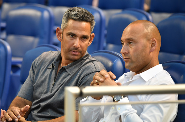 Boston Red Sox v Miami Marlins [arm,muscle,sitting,coach,games,recreation,competition event,ceo,jorge posada,derek jeter,v,miami,florida,miami marlins,boston red sox,new york yankee,game]