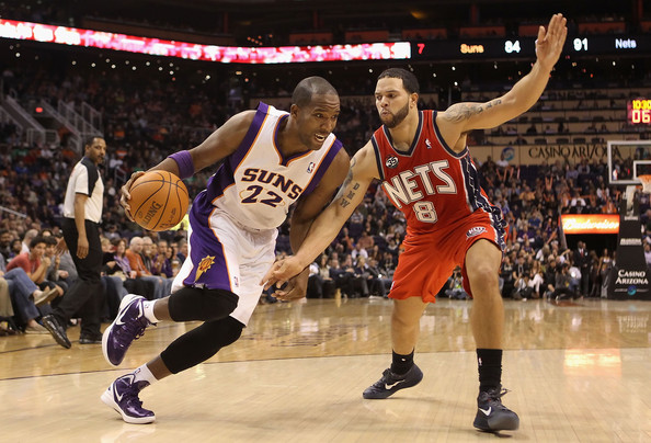 New Jersey Nets v Phoenix Suns [player,sports,basketball player,basketball court,tournament,basketball moves,team sport,ball game,sport venue,basketball,michael redd,user,deron williams 8,note,pressure,ball,phoenix,new jersey nets,phoenix suns,game]