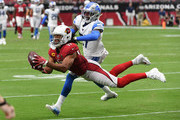 Larry Fitzgerald #11 of the Arizona Cardinals makes a diving catch while being defended by against the Detroit Lions at State Farm Stadium on September 08, 2019 in Glendale, Arizona.