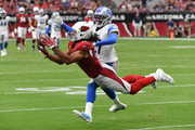 Larry Fitzgerald #11 of the Arizona Cardinals makes a diving catch while being defended by Tracy Walker #21 of the Detroit Lions during the fourth quarter at State Farm Stadium on September 08, 2019 in Glendale, Arizona.