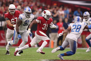 Running back David Johnson #31 of the Arizona Cardinals rushes the football against the Detroit Lions during the second half of the NFL game at State Farm Stadium on September 08, 2019 in Glendale, Arizona. The Lions and Cardinals tied 27-27.
