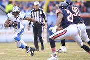 Reggie Bush #21 of the Detroit Lions runs the ball as Ryan Mundy #21 of the Chicago Bears  and Jeremiah Ratliff #90 of the Chicago Bears defend during the first quarter at Soldier Field on December 21, 2014 in Chicago, Illinois.