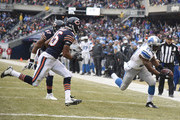Reggie Bush #21 of the Detroit Lions reaches for the endzone past Jon Bostic #57 of the Chicago Bears and Brock Vereen #45 for a touchdown during the first quarter at Soldier Field on December 21, 2014 in Chicago, Illinois.