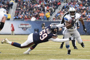 Reggie Bush #21 of the Detroit Lions runs past Jared Allen #69 of the Chicago Bears on his way to a touchdown run during the first quarter at Soldier Field on December 21, 2014 in Chicago, Illinois.