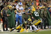 Golden Tate #15 of the Detroit Lions runs with the ball past Davon House #31 and Josh Jones #27 of the Green Bay Packers in the third quarter at Lambeau Field on November 6, 2017 in Green Bay, Wisconsin.