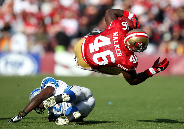Delanie Walker Delanie Walker #46 of the San Francisco 49ers is tackled by Anthony Henry #32 of the Detroit Lions during an NFL game at Candlestick Park on December 27, 2009 in San Francisco, California.
