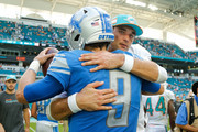 Matthew Stafford #9 of the Detroit Lions greets Brock Osweiler #8 of the Miami Dolphins after the game at Hard Rock Stadium on October 21, 2018 in Miami, Florida.