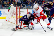 Sergei Bobrovsky #72 of the Columbus Blue Jackets and Justin Abdelkader #8 of the Detroit Red Wings battle for position during the game on March 9, 2018 at Nationwide Arena in Columbus, Ohio. Columbus defeated Detroit 3-2.