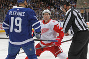 Dylan Larkin #71 of the Detroit Red Wings gets set to take a faceoff against Tomas Plekanec #19 of the Toronto Maple Leafs during an NHL game at the Air Canada Centre on March 24, 2018 in Toronto, Ontario, Canada. The Maple Leafs defeated the Red Wings 4-3. (Photo by Claus Andersen/Getty Images) *** Local Caption *** Dylan Larkin; Tomas Plekanec