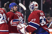 Tomas Plekanec #14 of the Montreal Canadiens and goaltender Antti Niemi #37 congratulate each other for their victory against the Detroit Red Wings during the NHL game at the Bell Centre on October 15, 2018 in Montreal, Quebec, Canada.  The Montreal Canadiens defeated the Detroit Red Wings 7-3.